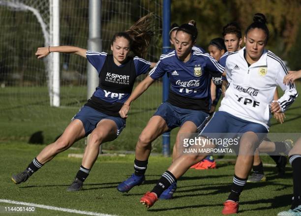 Argentina's woman footballers warmup before a friendly football match against Atlanta's youth team in Ezeiza Buenos Aires Argentina on May 16 in...