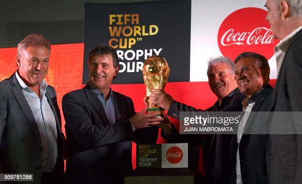 Argentina's World Cup Champions and former footballers Nery Pumpido Mario Kempes Jorge Burruchaga Hector Enrique and Alberto Tarantini pose with the...