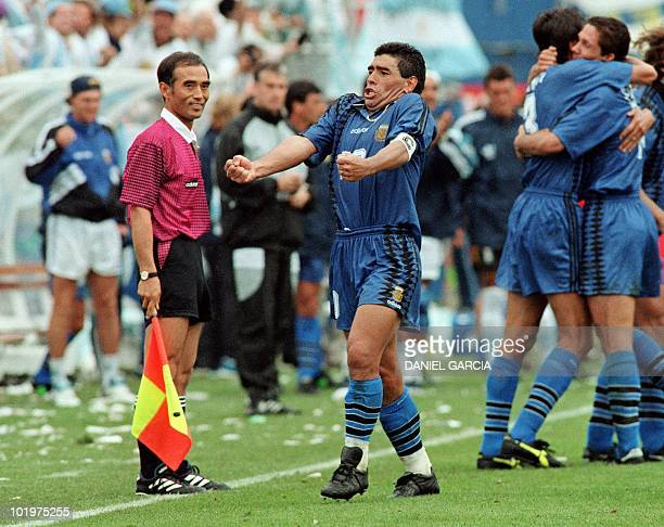 Argentina's World Cup soccer team Captain Diego Maradona yells out 21 June 1994 as he and his teammates celebrate after Argentina scored a goal in...