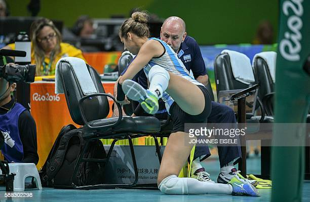 Argentina's Yael Castiglione crashes into seating after failing to reach a ball during the women's qualifying volleyball match between South Korea...