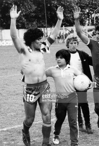 Argentina's young star Diego Maradona waves to the crowd after an Argentinos Juniors match Buenos Aires 1979 He is with his brother Hugo