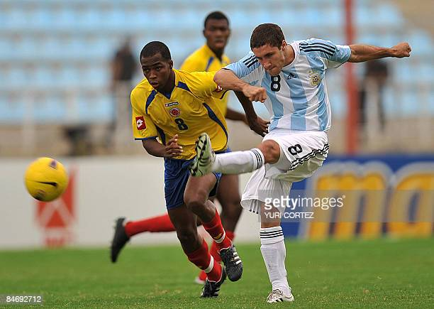 Argentina's Zuculini Franco kicks the ball marked by Colombia's Dawlin Leudo during their U20 South American Championship football match between...
