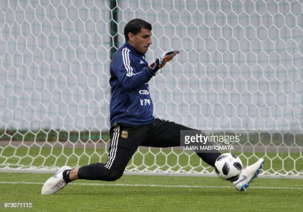 Argentina'sgoalkeeper Nahuel Guzman stops the ball during a training session at the team's base camp in Bronnitsy on June 13 2018 ahead of the Russia...