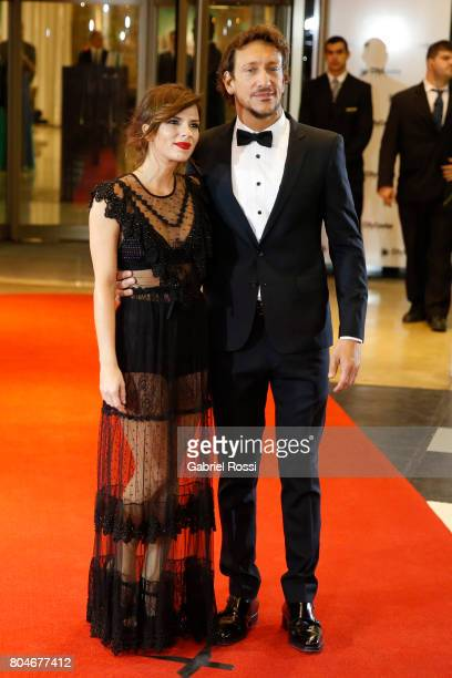 Argentine actor Nicolas Vazquez and his girlfriend Gimena Accardi pose for pictures on the red carpet during Lionel Messi and Antonela Rocuzzo's...