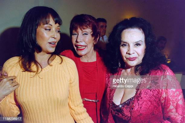 Argentine actress Isabel Sarli and Gladys del Valle Rojo 'Gogó Rojo' Castro attend the 'Gogó' inauguration party on March 23 2004 in Buenos Aires...