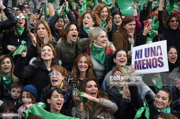 Argentine actresses along with dozens of other prochoice activists gather in front of the Argentine Congress in Buenos Aires on June 3 calling for...