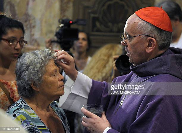 Argentine Archbishop Jorge Bergoglio draws the cross on the forehead of a believer during a mass for Ash Wednesday opening Lent the fortyday period...