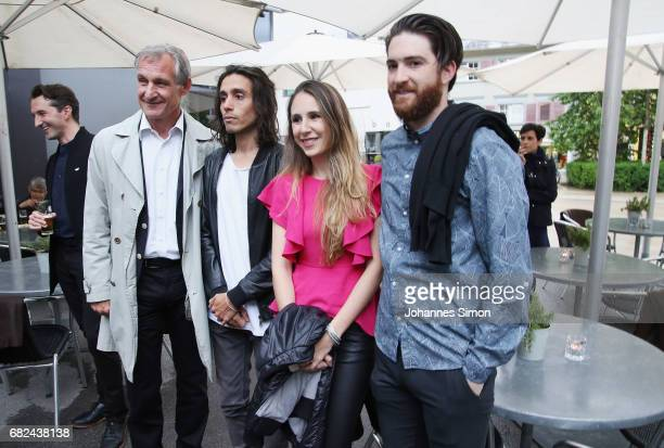 Argentine artist Adrian Villar Rojas poses with Bregenz lord mayor Markus Linhart and guests during the opening of his exhibition 'The Theater of...