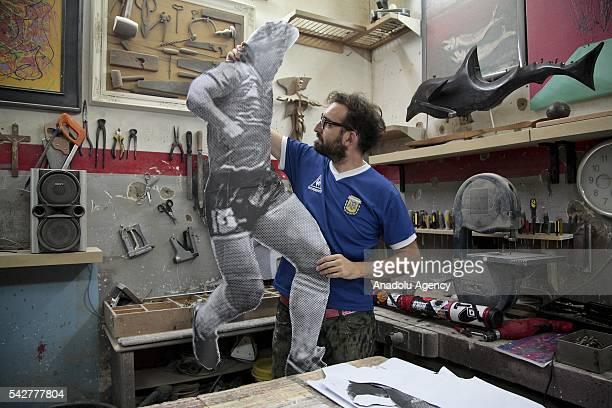 Argentine artist Santiago Spiga alias 'Spiga' prepares a mural depicting Argentine former football player Diego Armando Maradona to celebrate the...