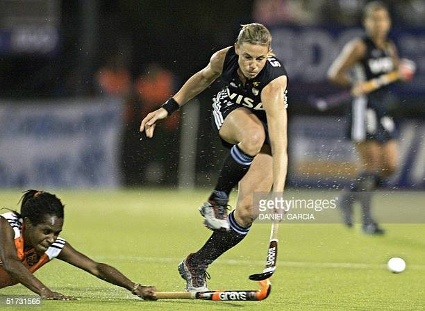 Argentine Ayelen Stepnik tries to past Dutch Maartje Scheepstra during the field hockey match for the Champions Trophy in Rosario Argentina 11...