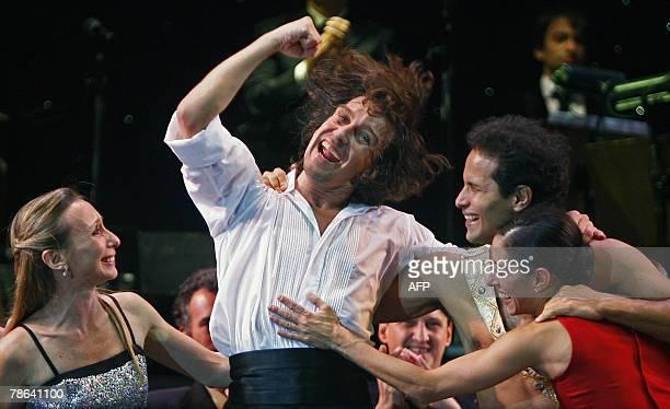Argentine ballet dancer Julio Bocca celebrates with colleagues Eleonora Cassano Manuel Legris and Cecilia Figaredo at the end of his farewell...