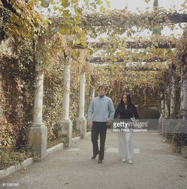 Argentine born actress Olivia Hussey and English actor Leonard Whiting pictured together walking under a vine covered pergola in Verona Italy in 1969...