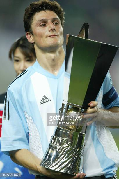 Argentine captain and defender Javier Zanetti holds the winner's trophy during an awarding ceremony at the Kirin Cup football against Japan at the...