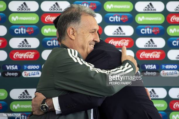 Argentine coach Gerardo 'Tata' Martino and the president of the Mexican Football Federation Yon de Luisa embrace each other during the former's...