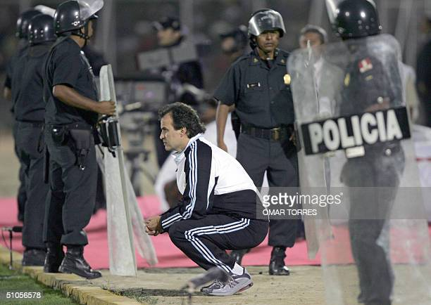 Argentine coach Marcelo Bielsa watches his team playing against Uruguay during their Group B Copa America soccer match 13 July 2004 at the Miguel...