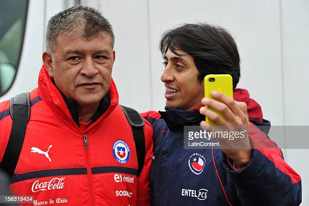 Argentine coach of Chile Claudio Borghi poses for a picture with a Chilean fan after a training at Spiserwies stadium November 13 2012 in Sait Gallen...