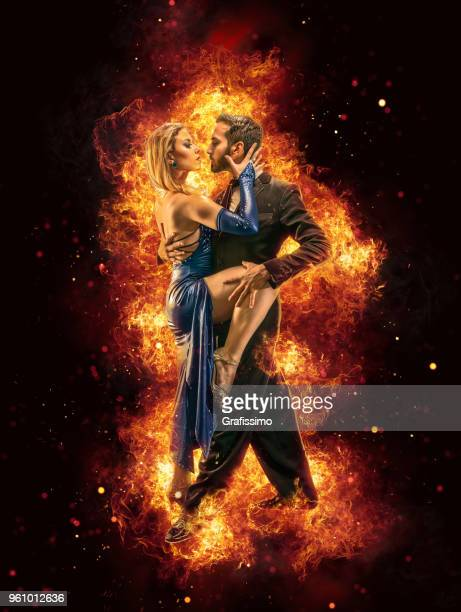 argentine couple dancing tango in buenos aires argentina surrounded by flames - argentina women stock pictures, royalty-free photos & images