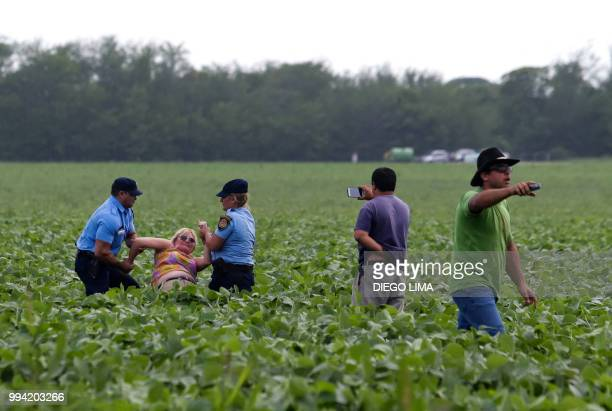 Argentine environmentalist Sofia Gatica is arrested by police officers as a farmer records the action and soybean field owner Alejandro Dalmasso...