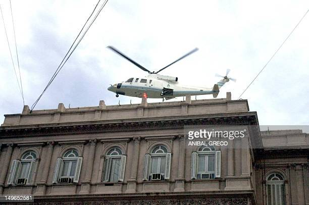 Argentine expresident Fernando de la Rua leaves the Casa Rosada in Buenos Aires by helicopter after resigning on December 20 2001 and is believed to...