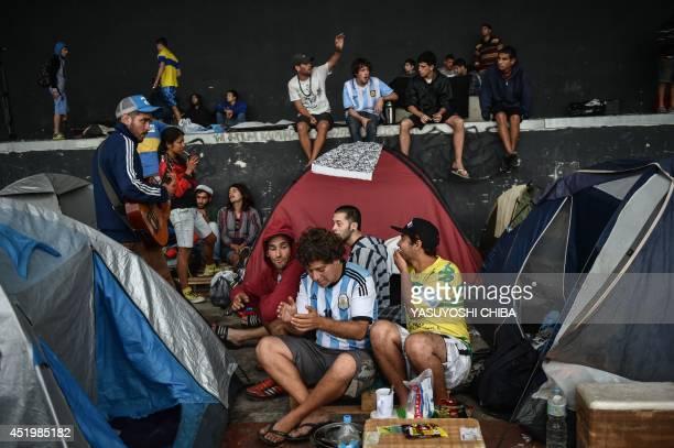 Argentine fans camp at Rio de Janeiro's Terreirao do Samba an openair area designed for carnival events where the city government has organized a...