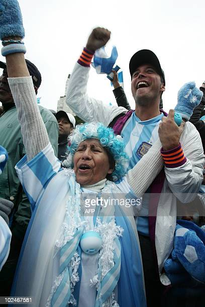 Argentine fans celebrate as they watch the FIFA World Cup South Africa 2010 football match against Mexico on an outdoor screen in Buenos Aires on...