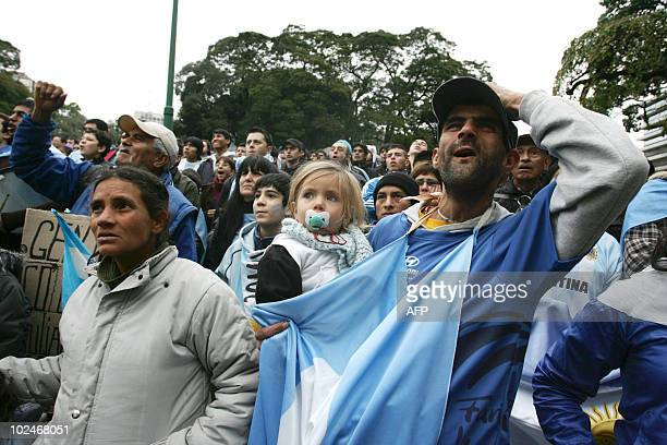 Argentine fans gestures as they watch the FIFA World Cup South Africa 2010 football match against Mexico on an outdoor screen in Buenos Aires on June...