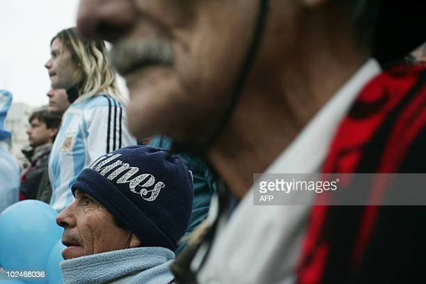 Argentine fans watch the FIFA World Cup South Africa 2010 football match against Mexico on an outdoor screen in Buenos Aires on June 27 2010...