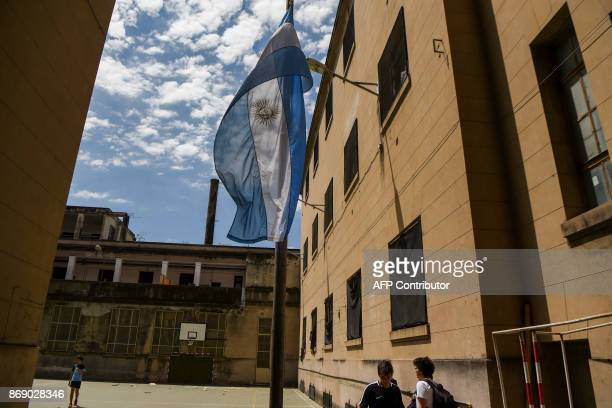 Argentine flag at halfmast is seen at the high school where were graduated 30 years ago the five Argentine killed tuesday during an attack in New...