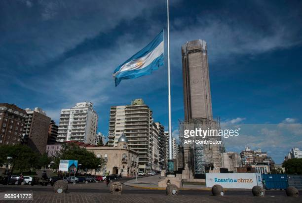 Argentine flag flies at halfmast in Rosario some 350 Km northwest of Buenos Aires Argentina on November 1 2017 as a sign of mourning for the five...