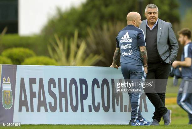 Argentine Football Association president Claudio Tapia talks with national football team coach Jorge Sampaoli during a training session in Ezeiza...