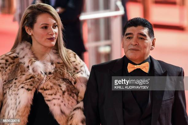 Argentine football legend Diego Maradona and his girlfriend Rocio Oliva arrive to attend the Final Draw for the 2018 FIFA World Cup football...