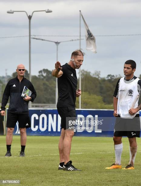 Argentine football referee Nestor Pitana gives instructions to a player during a video assistant referee training course at the headquarters of the...