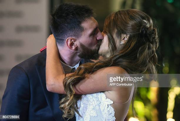 Kissing on the mouth stock photos and pictures getty images argentine football star lionel messi and bride antonella roccuzzo pose for photographers just after their wedding thecheapjerseys Image collections