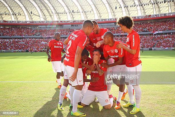 Argentine footballer Andres D'Alessandro , player of Brazilian team Internacional, celebrates with teammates after scoring during the friendly match...