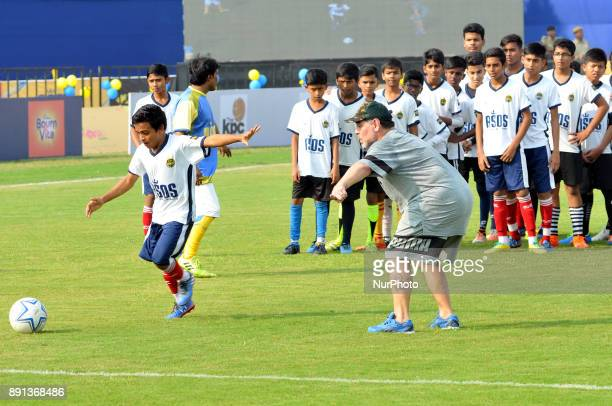 Argentine footballer Diego Maradona gestures during a football workshop with school students in Barasat around 35 Km north of Kolkata on December 12...