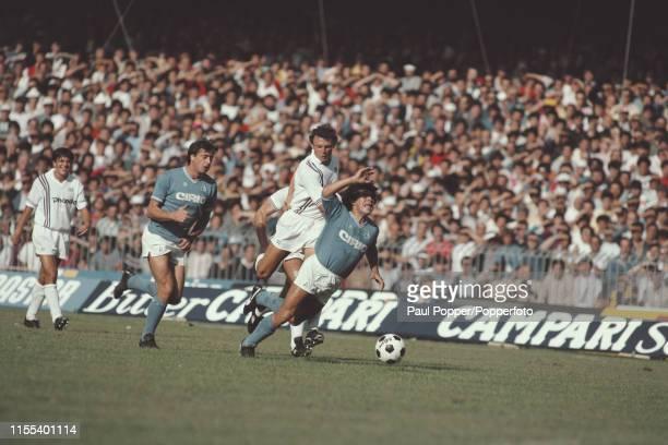 Argentine footballer Diego Maradona, midfielder/ striker with SSC Napoli, is fouled by Pietro Vierchowod of Sampdoria during the Serie A match...