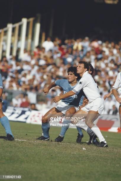 Argentine footballer Diego Maradona, midfielder/ striker with SSC Napoli, pictured on left closely marked by Pietro Vierchowod of Sampdoria during...
