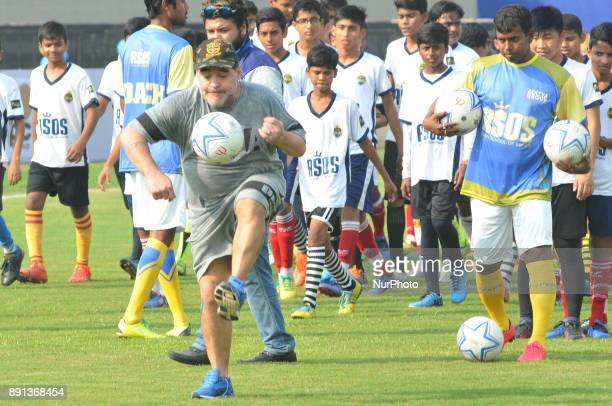 Argentine footballer Diego Maradona plays the ball during a football workshop with school students in Barasat around 38 Km north of Kolkata on...
