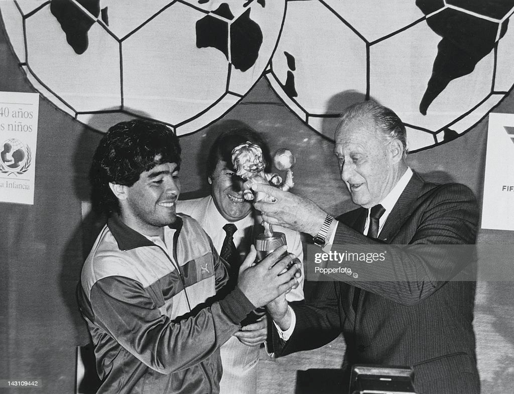 Argentine footballer Diego Maradona (left) receives the FIFA Fair Play Trophy, on behalf of the Argentine national team, from FIFA President Joao Havelange (right), 1978.
