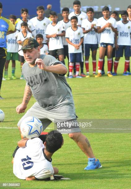 Argentine footballer Diego Maradona take a shot during a football workshop with school students in Barasat around 35 Km north of Kolkata on December...