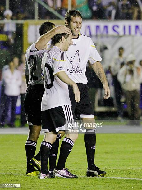 Argentine footballer Lionel Messi celebrates with teammates Cafu and Martin Palermo after scoring a goal in the Messi Friends v Rest of The World...