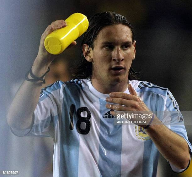 Argentine footballer Lionel Messi leaves the pitch during a FIFA World Cup South Africa2010 qualifier football match at the Mineirao stadium in Belo...