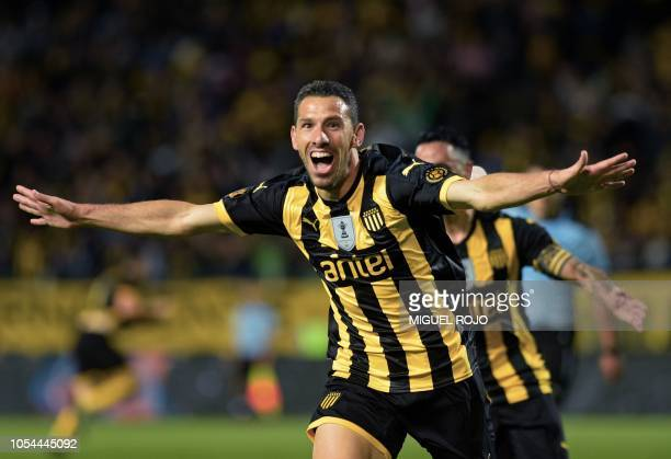 Argentine footballer Maxi Rodriguez of Penarol celebrates after scoring against Progreso in injury time to win 10 and obtain the Uruguayan Clausura...