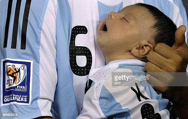 Argentine footballer Sergio Aguero holds his son Benjamin grandson of Argentina team coach Diego Maradona before their FIFA World Cup South...