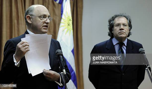 Argentine Foreign Minister Hector Timerman shows a bilateral comunnique signed by Argentine President Cristina Kirchner and her Uruguayan counterpart...