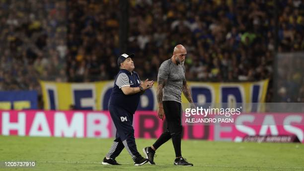 Argentine former football star Diego Maradona acknowledges spectators before the start the second half time of the Argentina First Division 2020...