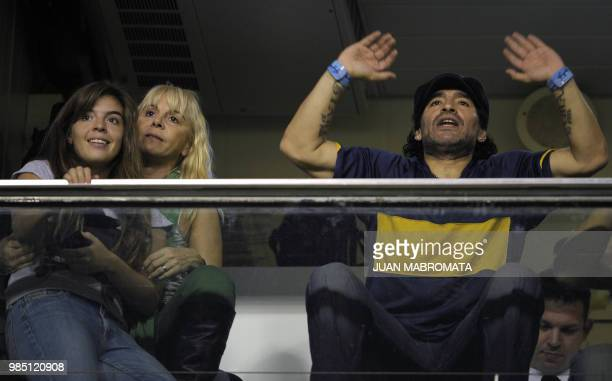 Argentine former footballer Diego Maradona cheers his team next to exwife Claudia Villafane and their daughter Dalma before the start the...