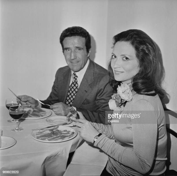 Argentine former professional footballer and manager of A S Roma football club Helenio Herrera pictured eating a meal with a female friend in a...