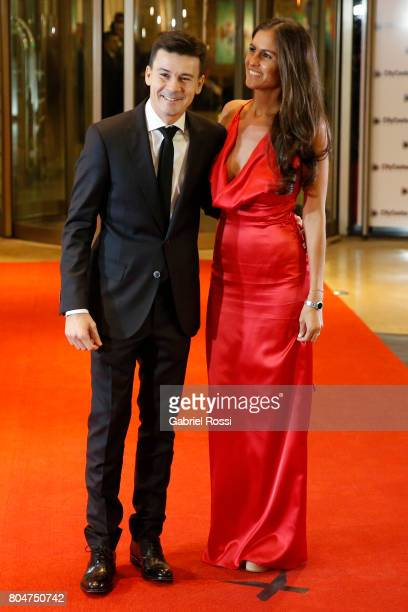 Argentine former tennis player Guillermo Coria and his wife Carla Francovigh pose for pictures on the red carpet during Lionel Messi and Antonela...