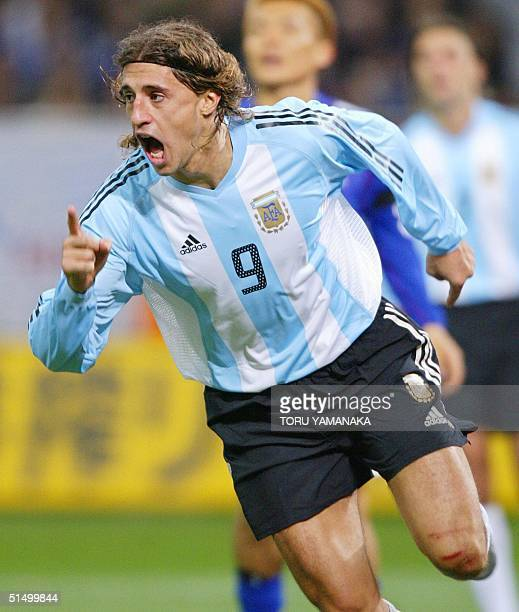 Argentine forward Hernan Crespo reacts with joy when he scores a goal during the second half of their friendly match at Saitama Stadium in Saitama,...
